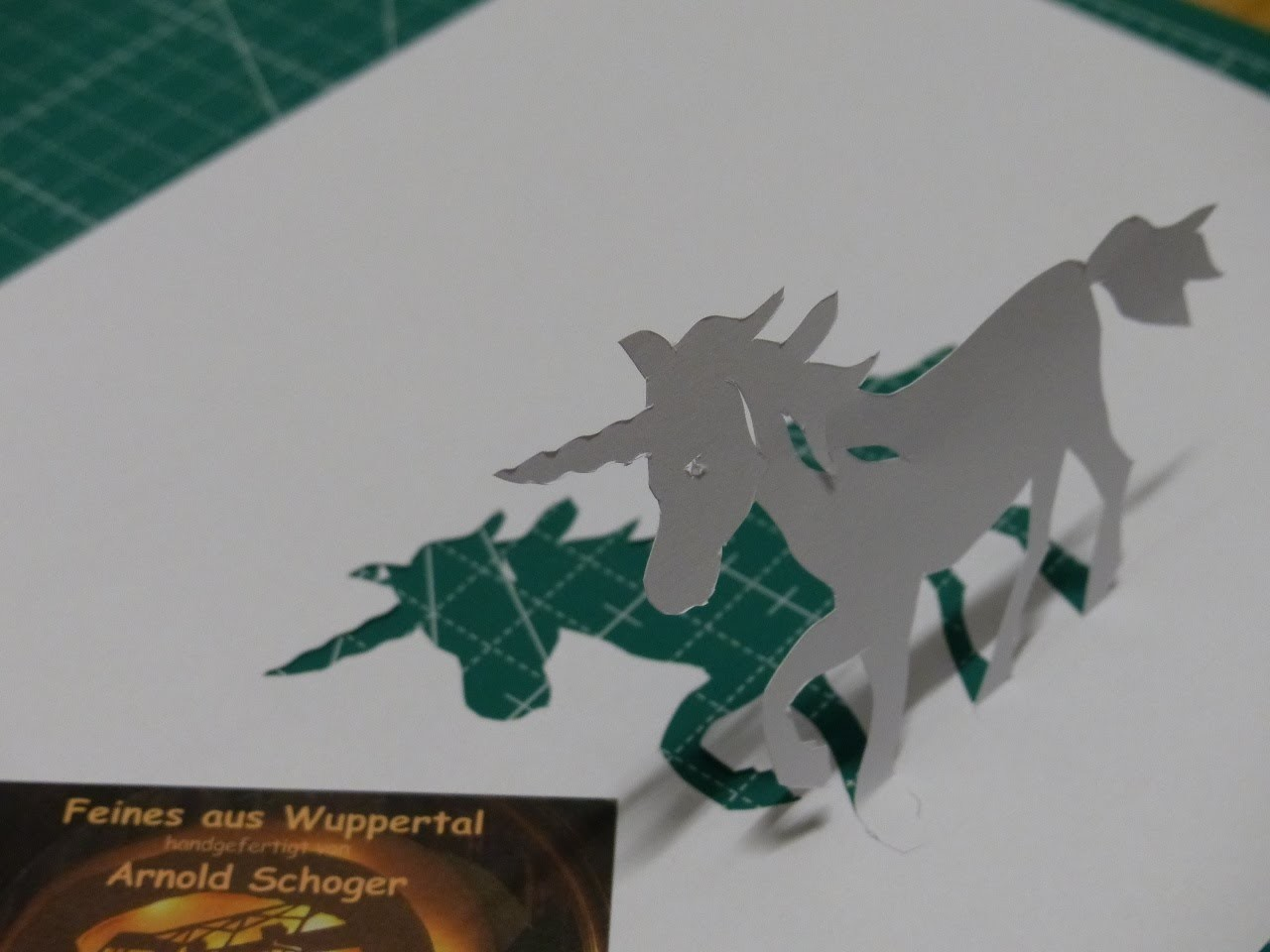 The white unicorn, a simple paper cut by Arnold Schoger