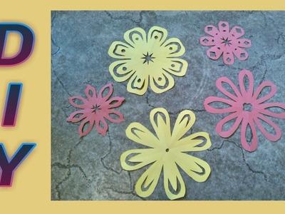 Basteln mit Papier. Blumen schneiden
