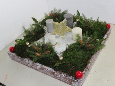 DIY.Selbst gemachter Stern als Adventskranz mit Moos dekoriert.