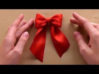 Schleife binden zum Geschenke verpacken.