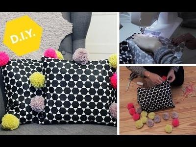 DIY: So bastelt Ihr ein Pompon-Kissen