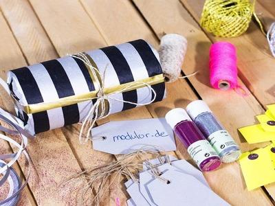 Tutorial: Runde Geschenke einpacken | Trusted Shops