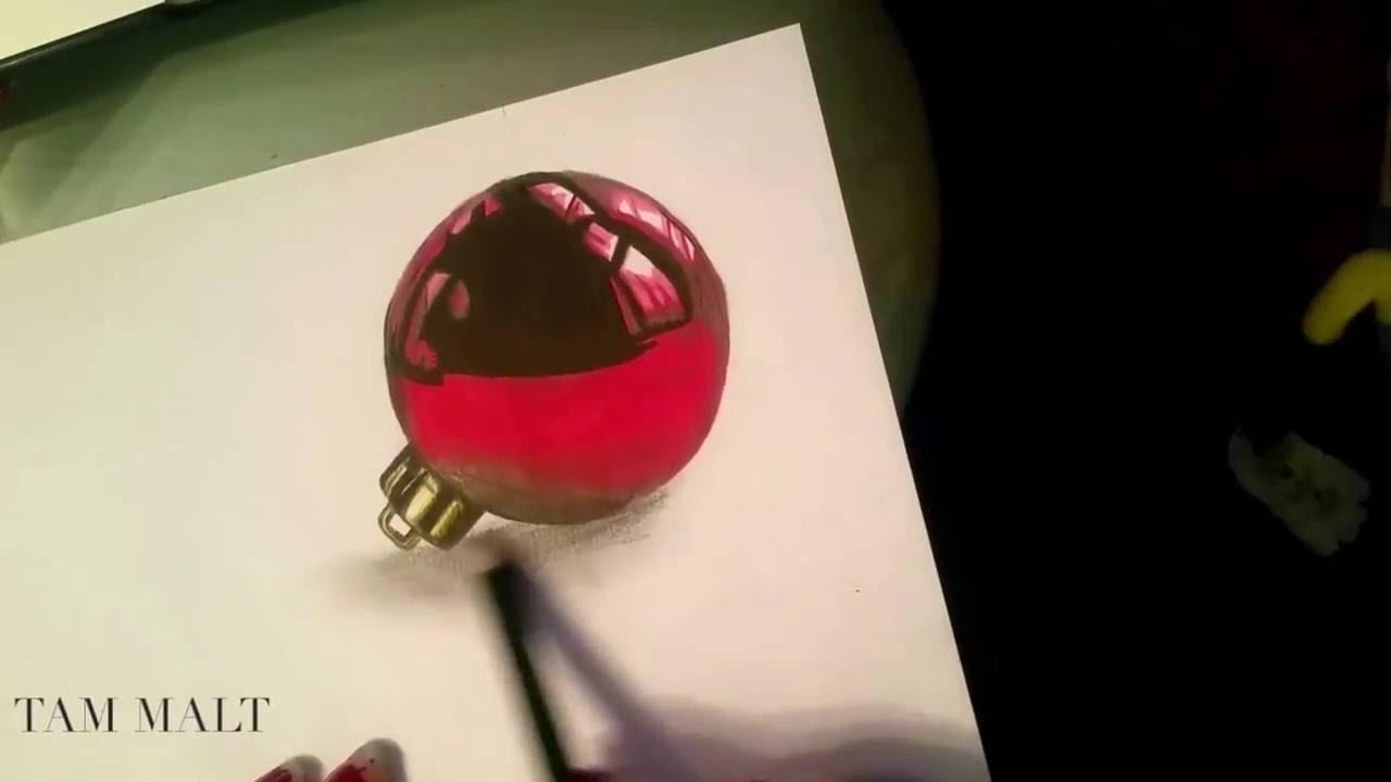 Tam malt eine 3D Weihnachtskugel